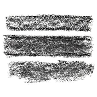 Set di strisce di carbone nero testurizzate isolate su sfondo bianco