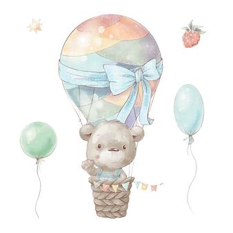 Set di orsacchiotto simpatico cartone animato in mongolfiera.