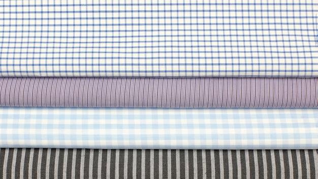 Set tessuto di cotone colorato di diversa consistenza. astrazione di sfondo del materiale tessile di fabbrica