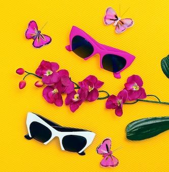Impostare gli occhiali da sole alla moda. tendenze estive