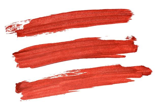 Set di pennellate acriliche rosse isolate su sfondo bianco
