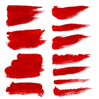 Set di tratto di pennello acrilico rosso isolato su sfondo bianco.