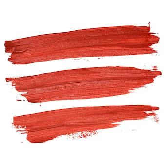 Set di pennellate rosse isolate su sfondo bianco