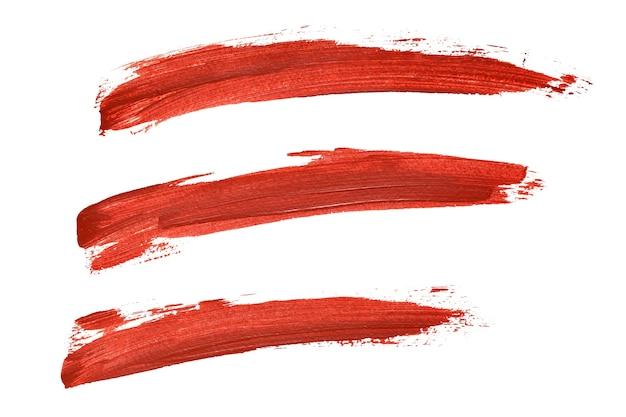 Set di linee di vernice rossa isolate su sfondo bianco
