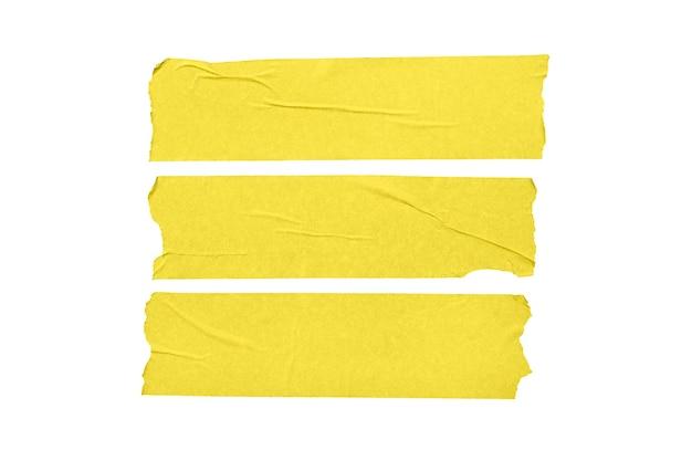 Set di adesivi di nastro in bianco gialli isolati su priorità bassa bianca.