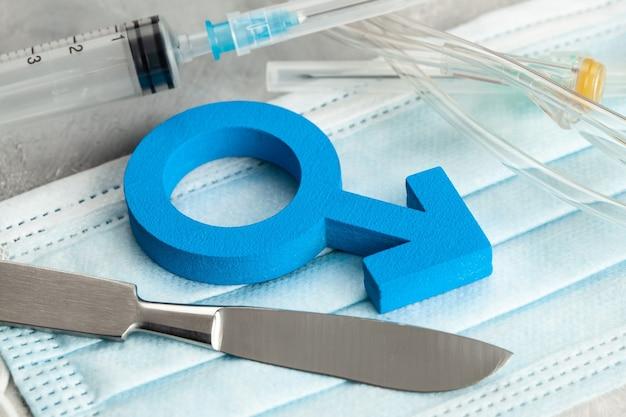 Operazione di cambio di sesso. cambio di maschio in femmina. simbolo di un uomo e di un bisturi con una siringa. strumenti chirurgici.