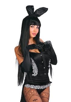 Playgirl sexy in costume da coniglietto su sfondo bianco Foto Premium