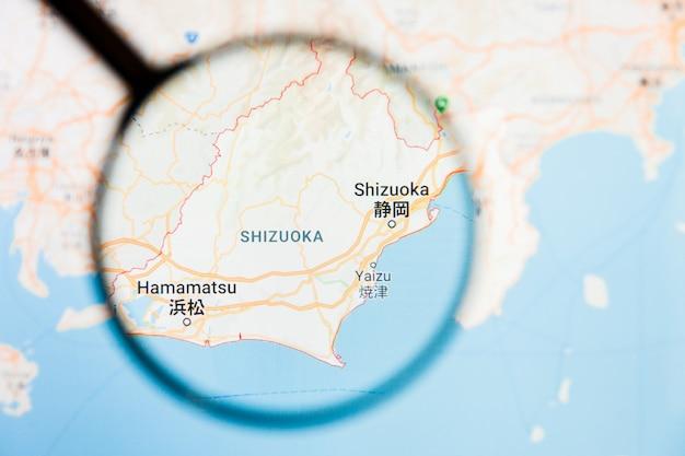 Concetto illustrativo di visualizzazione della città di shizuoka, giappone sullo schermo tramite la lente d'ingrandimento