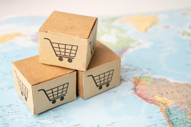 Logo del carrello della spesa sulla casella sulla mappa del globo del mondo. conto bancario, economia dei dati di ricerca analitica degli investimenti, commercio, concetto di società online di trasporto di importazione esportazione