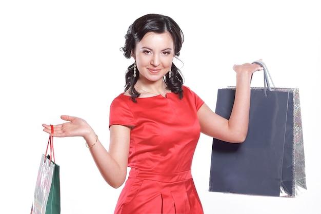 Sacchetti della holding della donna di acquisto, isolati su bianco