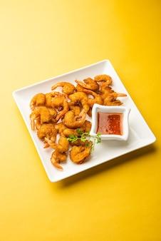 Frittelle di gamberetti o gamberi bajji o jheenga pakodaãƒâƒã'â'ãƒâ'ã'â o kolambi o zinga pakora, snack indiano