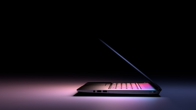 Vista laterale del pc portatile con luce di colore su oscurità. tecnologia concetto di gioco.