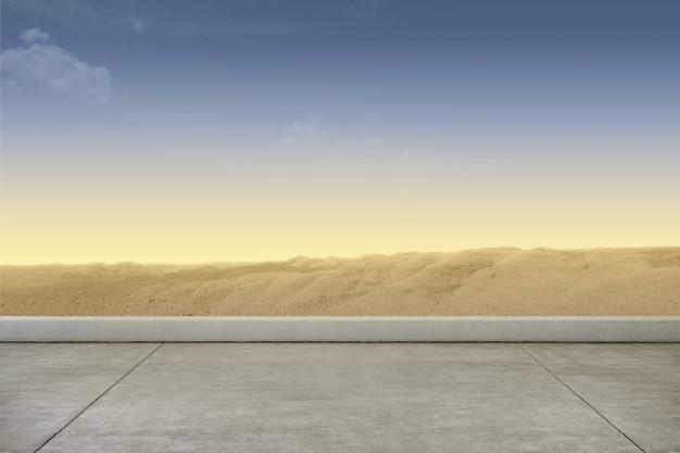 Marciapiede con sfondo di dune di sabbia