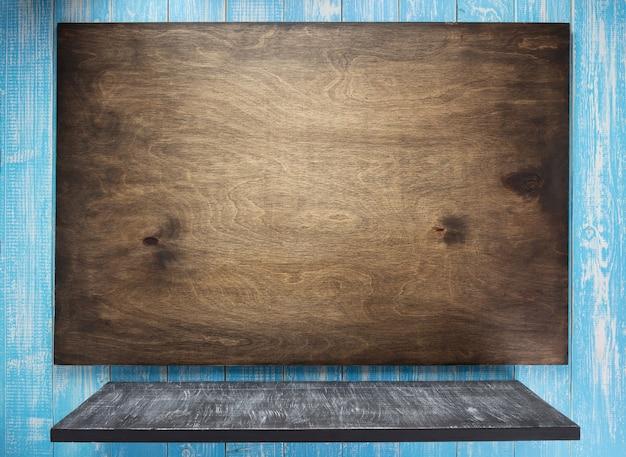 Cartello sulla superficie della trama del fondo in legno