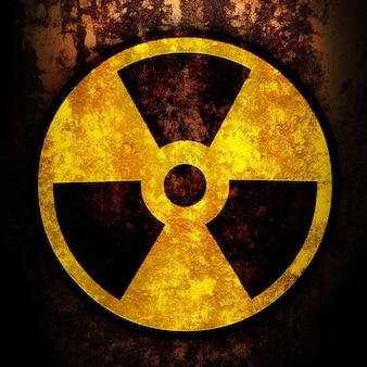 Segno di radiazione su una superficie arrugginita