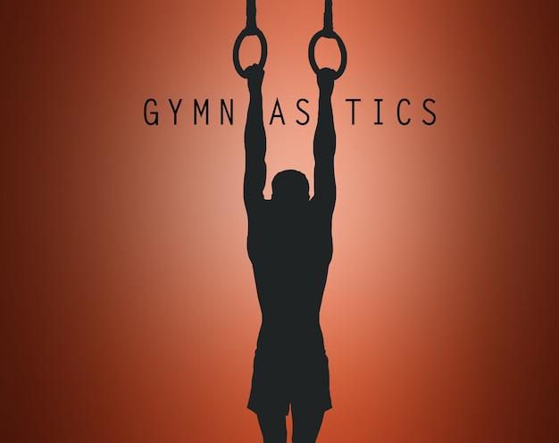 La silhouette dello sportivo che esegue esercizi difficili su anelli fissi, ginnastica sportiva