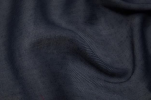Tessuto in seta o cotone. colore grigio scuro o nero. trama, sfondo, motivo.