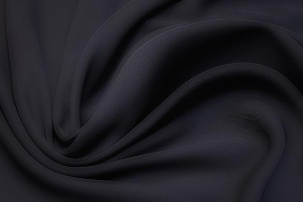 Tessuto di seta, cadì, colore nero nella disposizione artistica