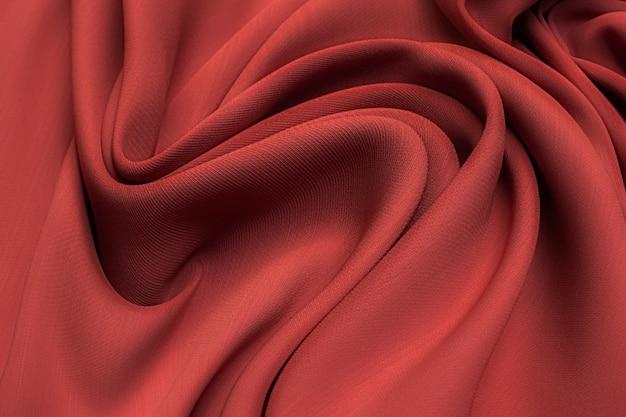 Tessuto di seta, cady, colori del corallo speziato in layout artistico