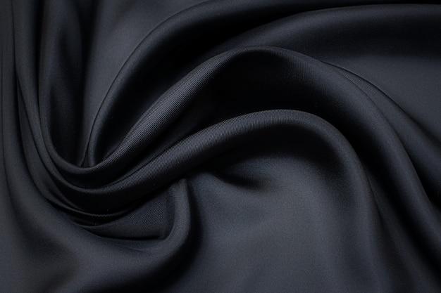 Tessuto di seta. colore blu scuro. trama, sfondo, motivo.