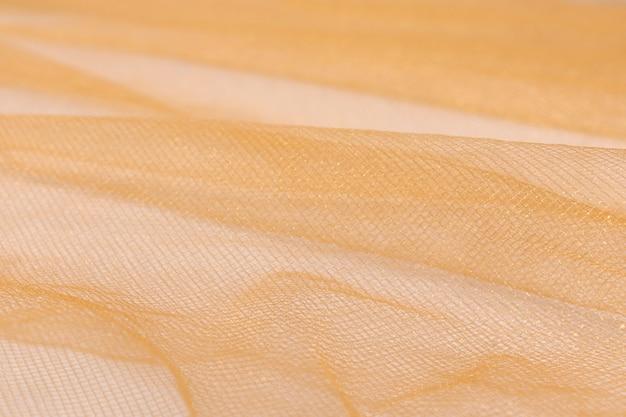 Tessuto di seta, l'organza è beige chiaro, trama ondulata del tessuto