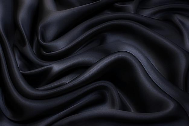 Tessuto di seta, raso. il colore è grigio. trama, sfondo, motivo.