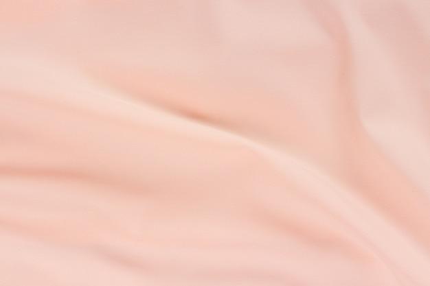 Tessuto di seta rosa onde sfondo full frame texture