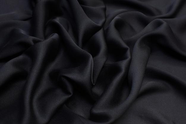 Tessuto di raso di seta. colore nero. struttura,