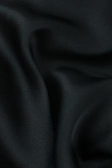 La trama del tessuto di lusso in seta o raso può essere utilizzata come sfondo astratto. vista dall'alto.