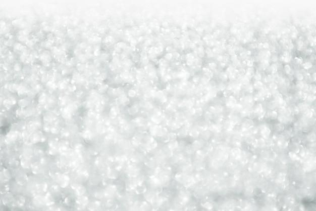 Struttura del bokeh di sillver. sfondo glitter festivo con luci sfocati.
