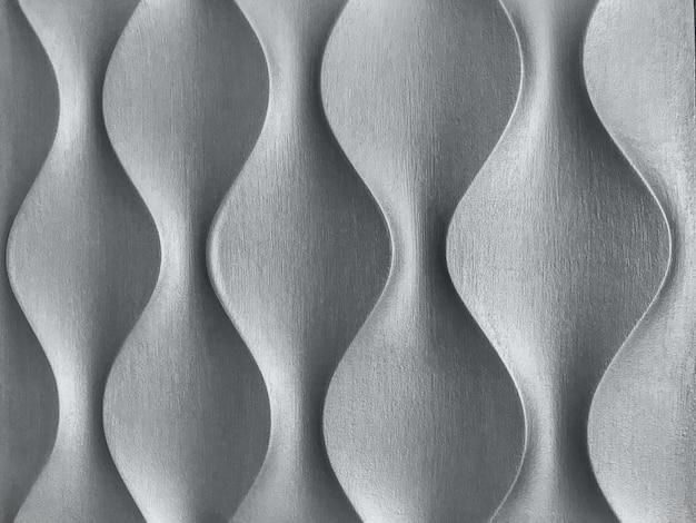 Pannello murale decorativo interno 3d argento con forma geometrica ondulata. sfondo grigio metallizzato