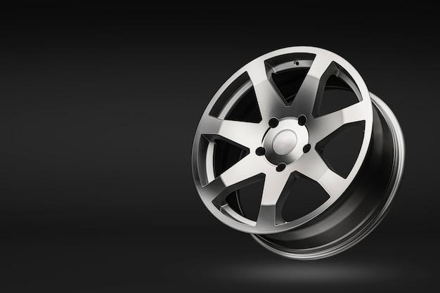 Cerchi in lega di alluminio argento, su uno sfondo nero sfumato. copia spazio e mockup