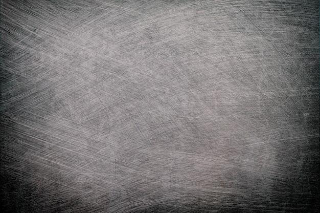 Struttura in metallo spazzolato argento con sfondo di vignetta.