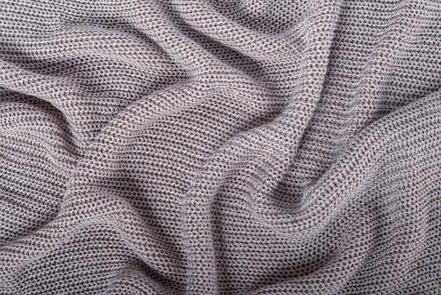 Fondo astratto di struttura lavorata a maglia del filato del metallo d'argento