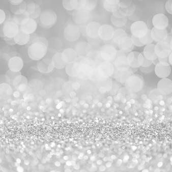 Sfondo di display quadrato bokeh di particelle d'argento