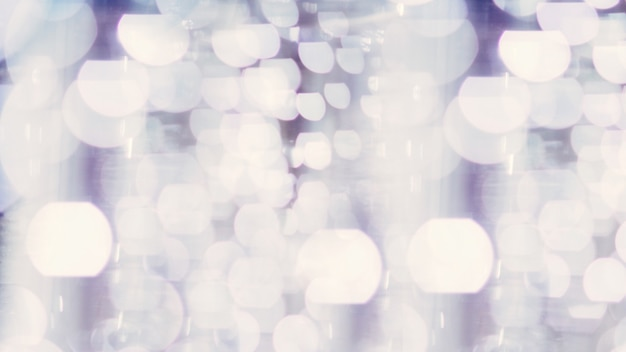 Luci bokeh argento e bianche sfocate. sfondo astratto