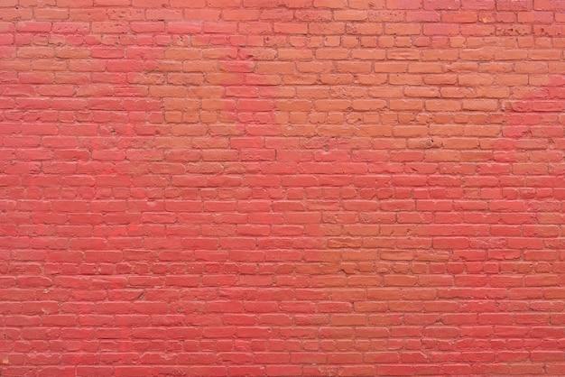 Semplice muro di mattoni rossi sullo sfondo Foto Premium