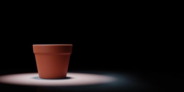 Unico vaso di fiori vuoto messo in evidenza su sfondo nero