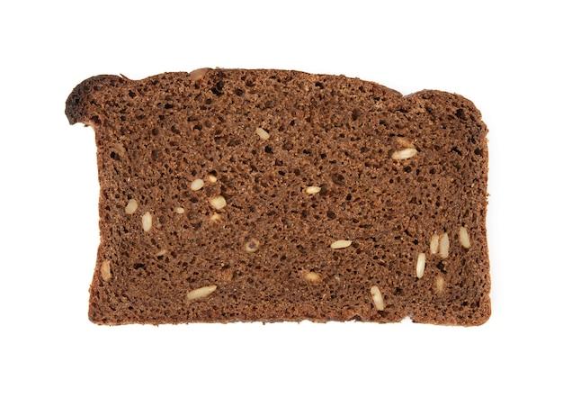 Fetta di pane di farina di segale con semi di girasole isolati su sfondo bianco, vista dall'alto