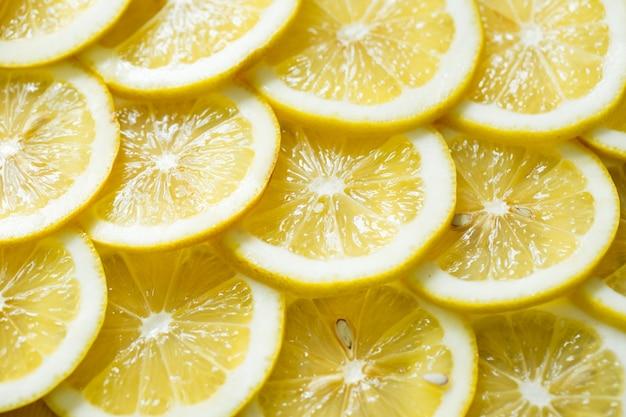 Fette di pattern di sfondo texture limone giallo fresco