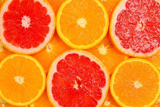 Fette di arance e pompelmi come sfondo