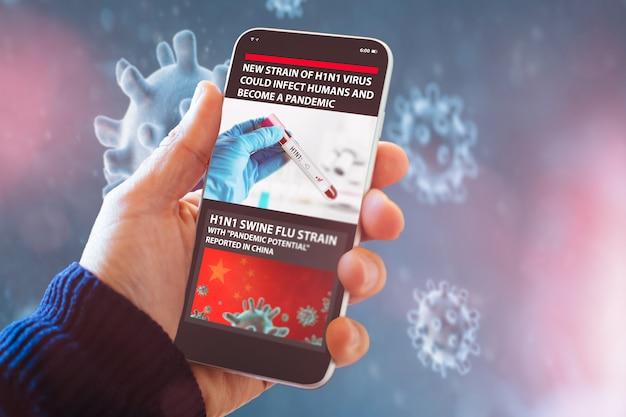 Smart phone che mostra le notizie sul nuovo virus h1n1