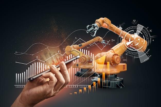 Smartphone in mano d'uomo e braccia robotiche di un impianto moderno. concetto di tecnologia iot, fabbrica intelligente. operazione di produzione digitale. industria 4.0.