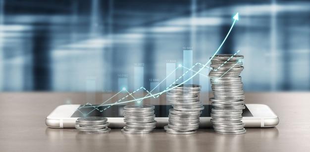 Schermo dello smartphone accanto a pile crescenti di monete e indicatori positivi del grafico nella sua attività