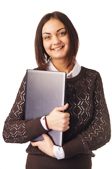 Donna sorridente di affari che tiene un computer portatile