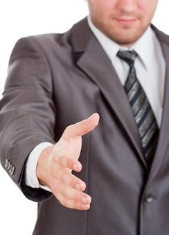 L'uomo d'affari sorridente sta per stringere la mano