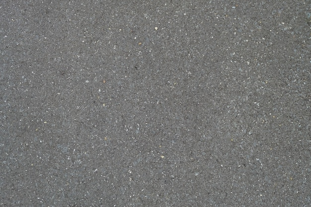Texture di strada asfaltata liscia del modello di design nero, sfondo vista dall'alto.