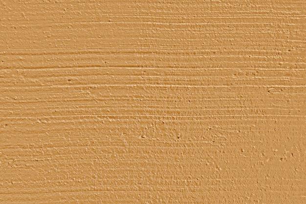 Superficie liscia in argilla marrone, primo piano con struttura a parete piatta