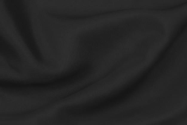 Tessuto di seta nera elegante liscio o tessuto di raso di lusso può essere utilizzato come sfondo del matrimonio. per drappeggi lussuoso disegno astratto