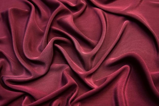 Liscio seta rosa bordeaux elegante o tessuto di raso sfondo texture per il design